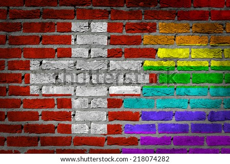 Dark brick wall texture - coutry flag and rainbow flag painted on wall - Switzerland - stock photo