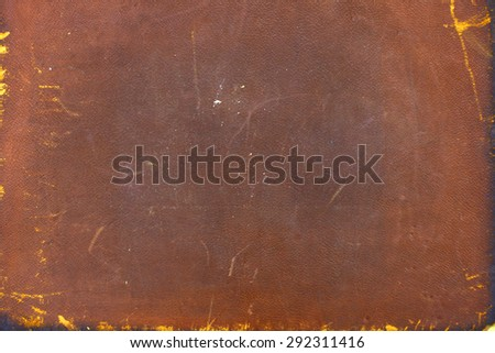 Dark brown and red, partially burnt book cover for background - stock photo