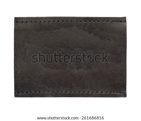 dark brown blank leather jeans label on white - stock photo