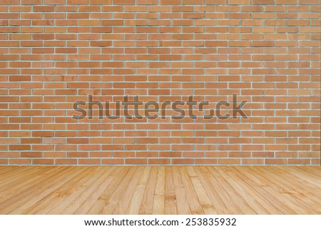 Dark brown brick wall and wooden floor  - stock photo