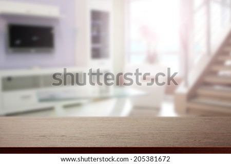 dark brown desk and interior of sunlight space  - stock photo