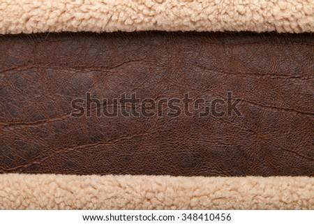 dark brown leather background, grungy texture design and fur grunge border - stock photo