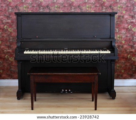 dark brown piano with bench - stock photo