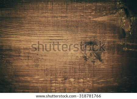 Dark brown scratched wooden cutting board. Wood texture - stock photo
