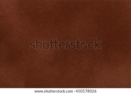 Dark brown suede fabric closeup. Velvet texture background
