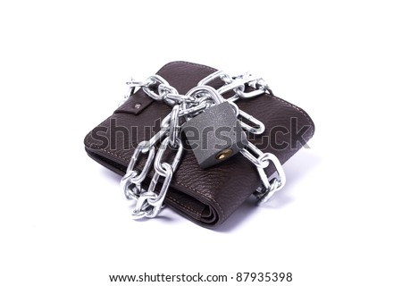 dark brown wallet with chain and padlock wrapped around the closed white background - stock photo