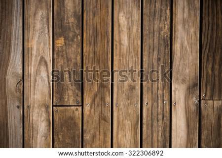 Dark brown wood plank with screw background. - stock photo