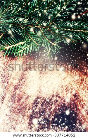 Dark brown wood texture with white snow,  stars and fir tree  in vintage style . Christmas background. Christmas card - stock photo