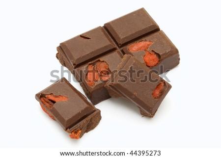 dark chocolate and goji berries - stock photo
