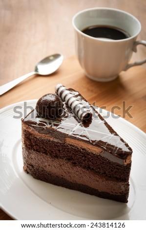 Dark chocolate cake with black coffee,dessert - stock photo