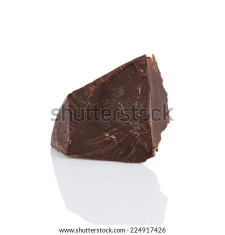 dark chocolate chunk, isolated on white background with reflection