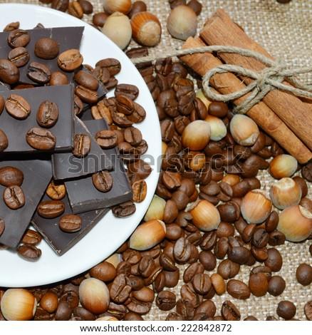 dark chocolate,coffee beans,chocolate,nutmeg,cinnamon - stock photo