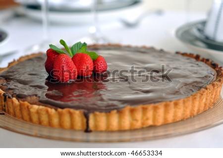 Dark chocolate ganache tart with strawberries - stock photo