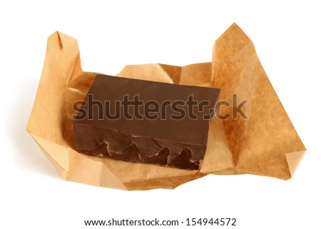Dark chocolate in paper on a white background - stock photo