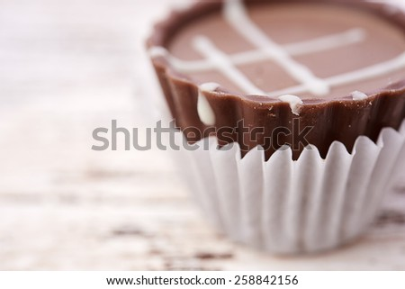 Dark chocolate on wooden background - stock photo