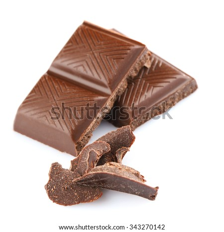 Dark chocolate pieces isolated on white - stock photo