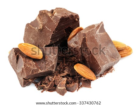 Dark chocolate pieces, shavings and almonds isolated on white - stock photo