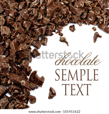 Dark chocolate shavings on a white background - stock photo