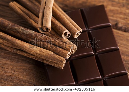 Dark chocolate with candy sweet, dessert food, cinnamon