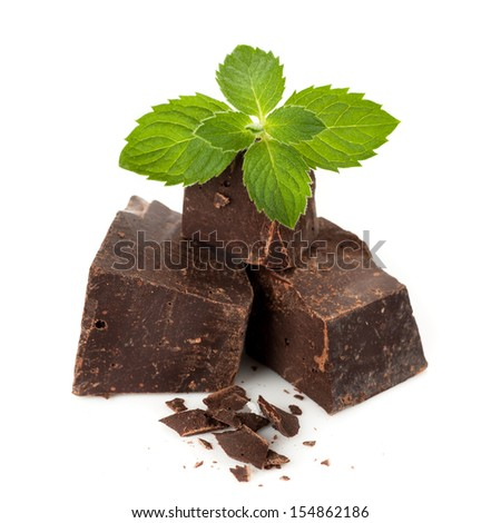 Dark chocolate with mint leaves - stock photo