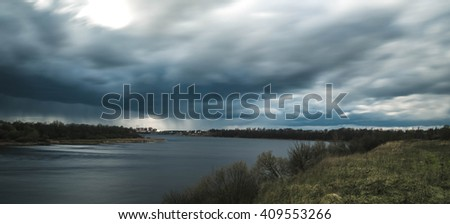 dark clouds before the rain on the river