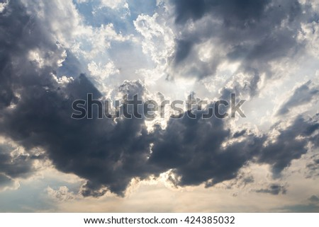 Dark clouds on blue sky background - stock photo