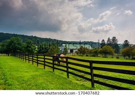 Dark clouds over a farm in rural York County, Pennsylvania. - stock photo