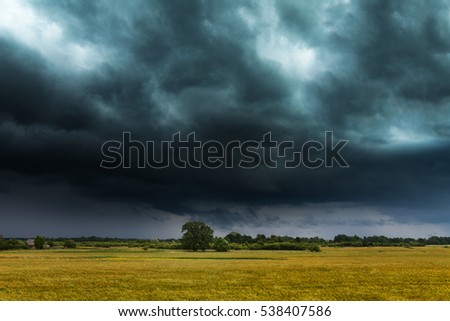 Dark clouds over grain field.