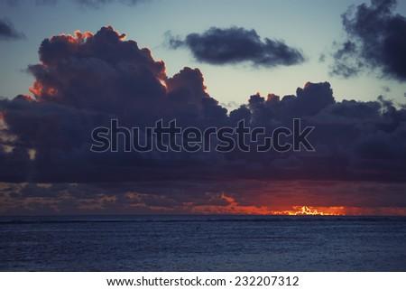 Dark Clouds over Sea at Dusk - Rarotonga, Cook Islands, Polynesia - stock photo