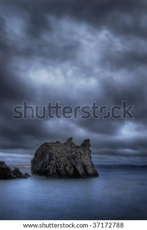 Dark clouds over the sea in Torquay, UK - stock photo