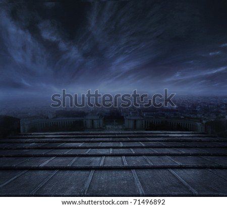 Dark clouds over urban background - stock photo