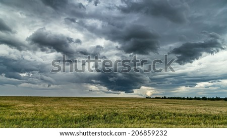 Dark clouds promise rain. - stock photo