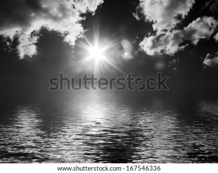 Dark cloudy sky with sun over simulated water - stock photo