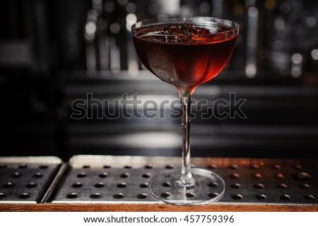 dark cocktail on a  bar setting - stock photo