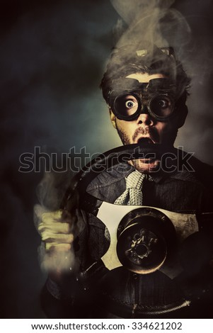 Dark creative concept portrait of a nerd business man holding steaming auto wheel during a fast pace race competition. Street racer - stock photo