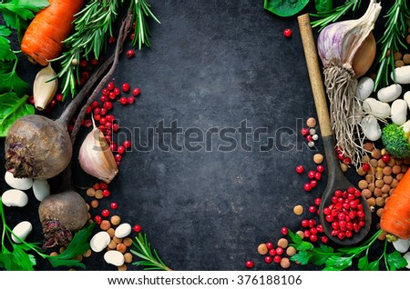 Dark culinary background with fresh farm vegetables, top view - stock photo