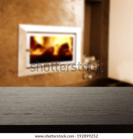 dark desk and fireplace  - stock photo