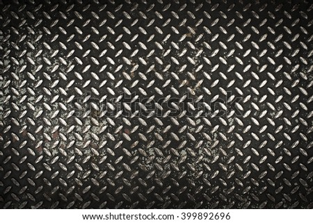 Dark, dirty, rusty and grunge  diamond steel metal sheet  for background - stock photo