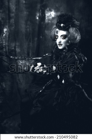 Dark Doll. Young woman in holiday image of mystery gothic doll.