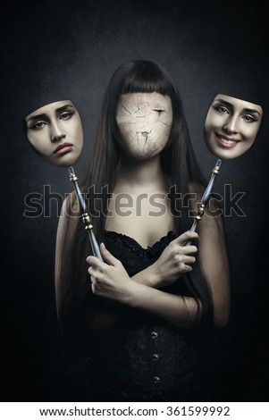 Dark faceless woman deciding which mask to wear. Surreal and horror - stock photo