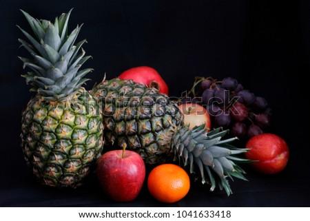 dark food chiaroscuro lighting on pineapple stock photo royalty