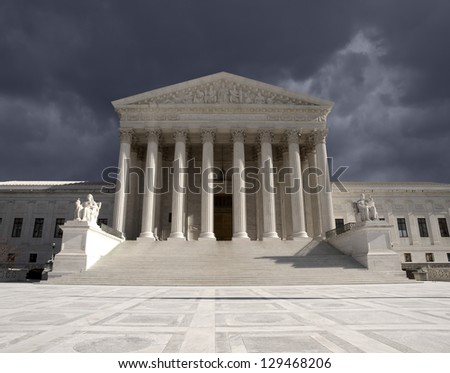 Dark forbidding storm sky over the United States Supreme Court building in Washington DC. - stock photo
