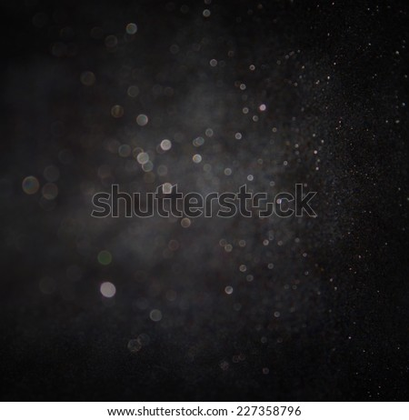 dark glitter vintage lights background. light silver and black. defocused.  - stock photo