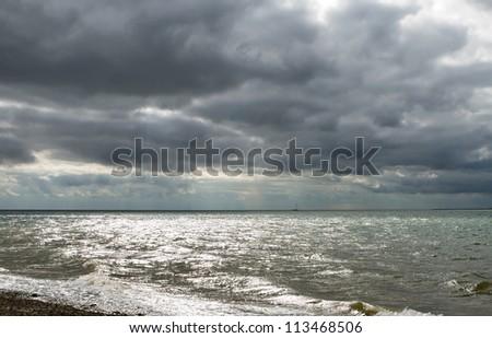 Dark gloomy day on a Uk beach - stock photo