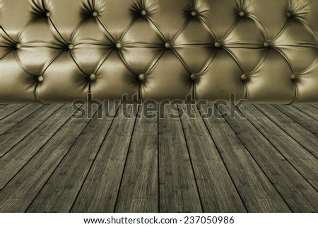 dark gold  leather seat with dark wood texture plank panel timber background - stock photo