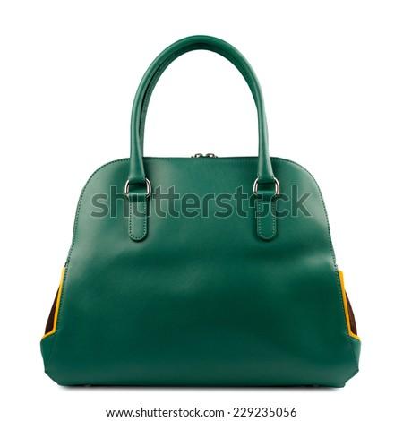 Dark green  handbag isolated on white background. - stock photo