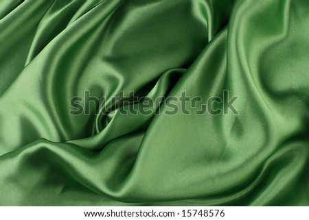 Dark green liquid satin texture - stock photo