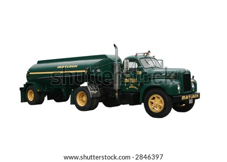 dark green side view of a Matlack fuel tanker truck and trailer, isolated on white. - stock photo