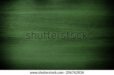 Dark green wood. Natural texture background. Vignette and shadow effect. - stock photo