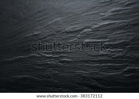 Dark grey / black slate texture, floor tile, wallpaper or background. Rough texture with fine details. - stock photo